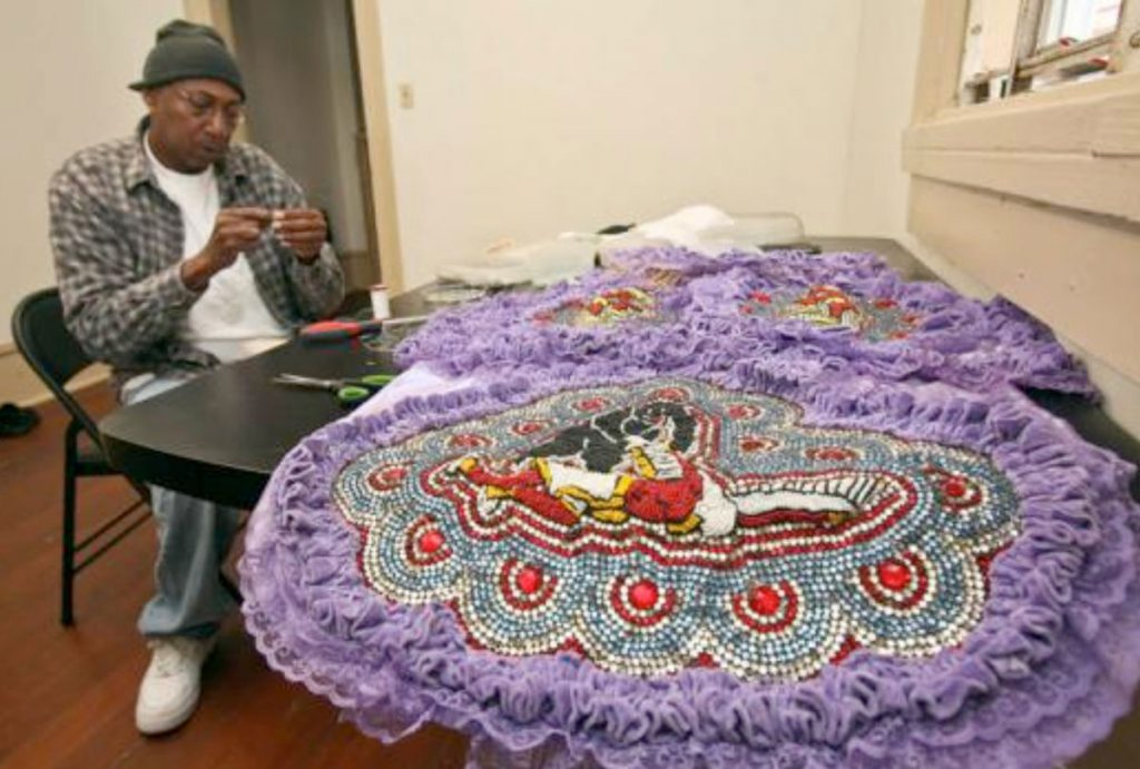 Big Chief Howard Miller of the Creole Wild West Mardi Gras Indians makes patches for his suit. Photo: Zada Johnson