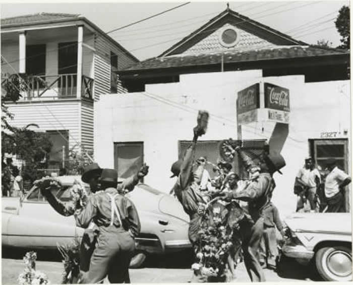 Jolly Bunch second line dancing to Young Tuxedo Brass Band, 1958. Photo Credit: Ralston Crawford