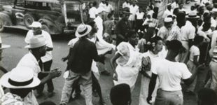 People dancing in the street 1953. Photo Ralston Crawford