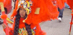 Young Mardi Gras Indian masquerades in his beautiful Indian suit. Photo: Zada Johnson