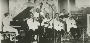 Papa Celestin's Original Tuxedo Orchestra; Jeanette Kimball, Joseph Thomas ('Brother Cornbread or 'Empty Mouth'), Sidney 'Jim Little' Brown, Albert French, Albert 'Fernandez' Walters, Louis Barbarin, Wendell Eugene. Dan's Pier 600, New Orleans, LA. circa 1959; Courtesy of Hogan Jazz Archive, Tulane University