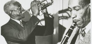 Bunk Johnson Band; George Lewis, cl, with Bunk Johnson, tp; playing a Town Hall concert.; Hogan Jazz Archive Photography Collection; Photo Credit: Skippy Adelman